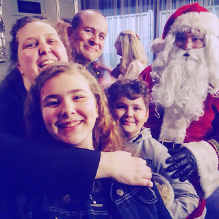 The A Mother's Ramblings Family with Santa