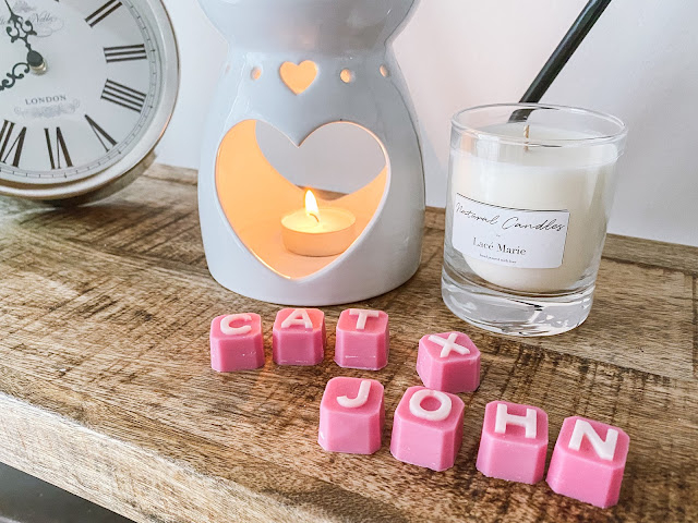 Pink personalised wax melts in front of a wax melter