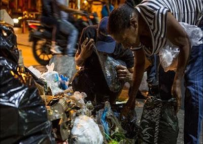 Venezuelanos famintos brigam por restos de comida nos lixões