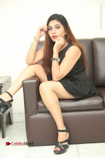 Tollywood Upcoming Actress Pooja Roshan Stills in Black Short Dress at Plus 1 Movie Trailer Launch  0338.JPG