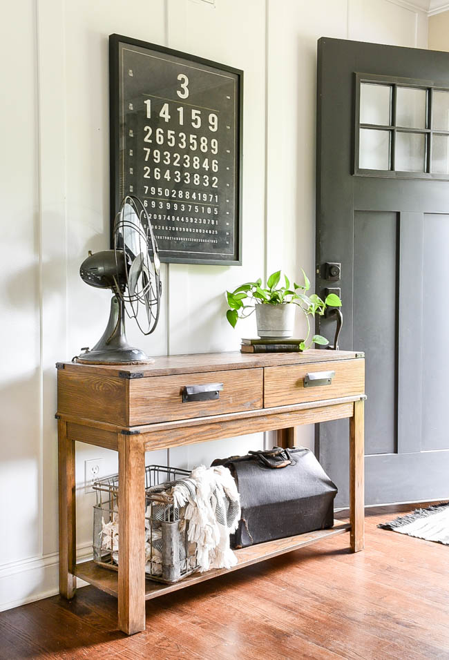 Spring entryway with faux concrete painted planter