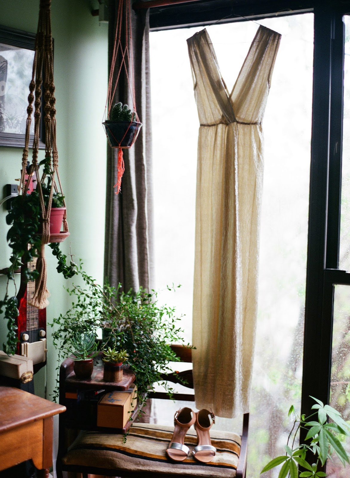 gold wedding dress hanging in an eclectic Brooklyn, new york loft