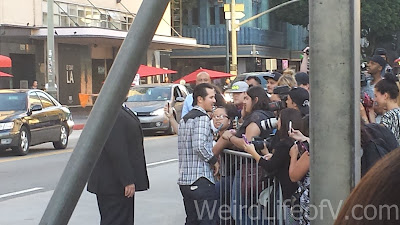 John Leguizamo signing autographs at the American Ultra Red Carpet Premiere