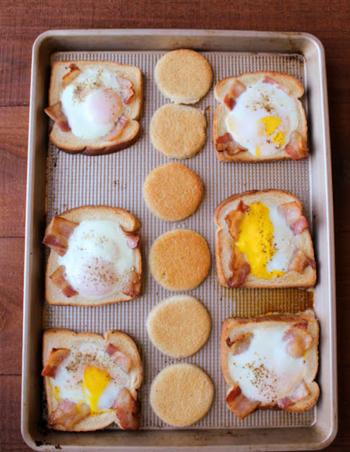sheet pan filled with bacon and eggs in a hole fresh from the oven
