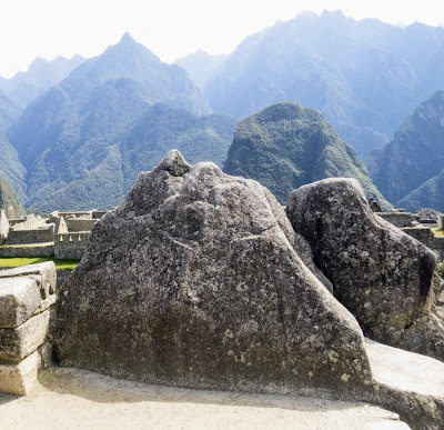 Images of Machu Picchu: Ceremonial rocks that resemble the Andes in the distance at Machu Picchu