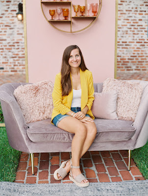 Jaclyn Fraser wedding planner smiling on couch