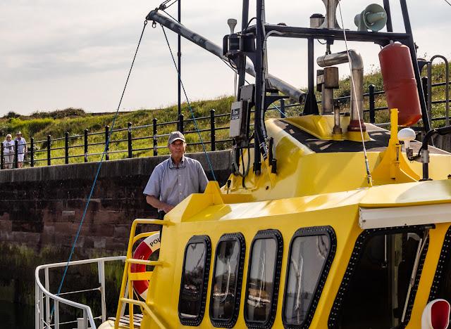 Photo of David Scott Cowper at the helm of Polar Bound