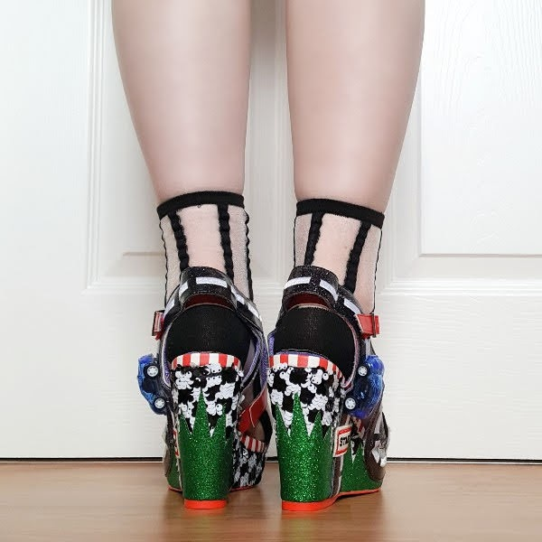 back of shoes in green glitter and black and white grid patterned sequins