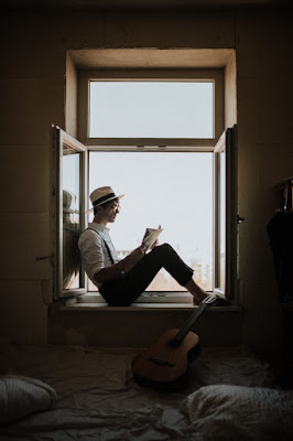 Melancholy Artist Reading Details