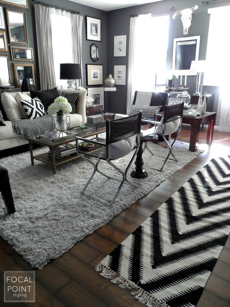 Focal point styling on trend with thrift finds tips in - Black and white and grey living room ...