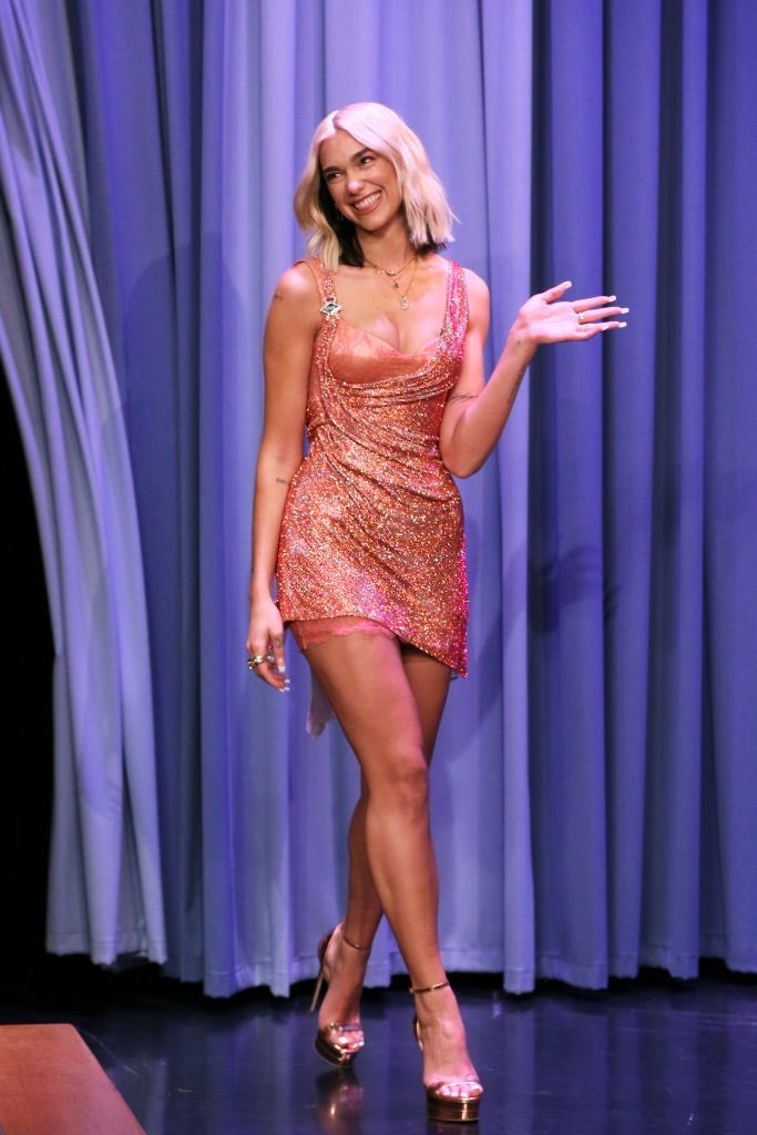 Dua Lipa flashes bra in metallic pink mini dress as guest on The Tonight Show Starring Jimmy Fallon