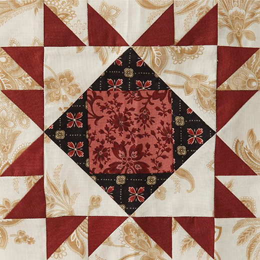 Mystery Quilt Block 5 Free Pattern designed by Monique Dillard of Open Gate Quilts