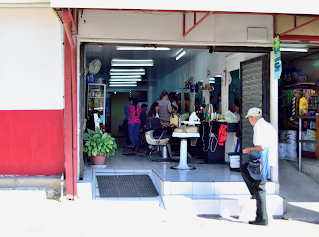 Man stepping into hair salon in Puriscal