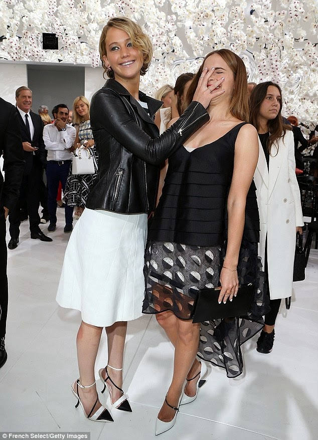 Jennifer Lawrence facepalms Emma Watson at the Dior Fall 2014 Couture Show in Paris