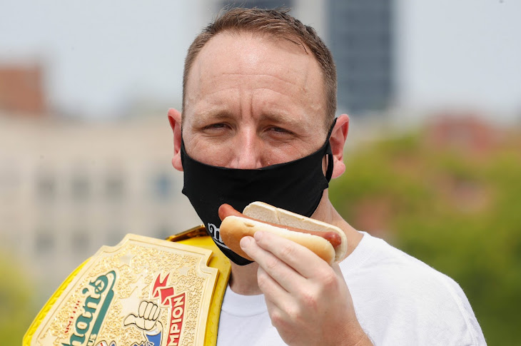 Joey Chestnut Sets Record With 75 Hot Dogs
