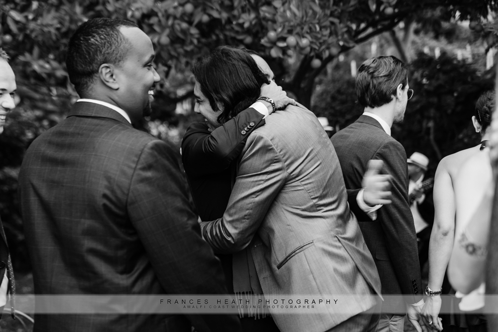 Guest hugging groom