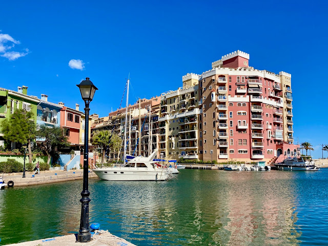 Canals, boats and coloured houses in Port Saplaya, Valencia, Spain