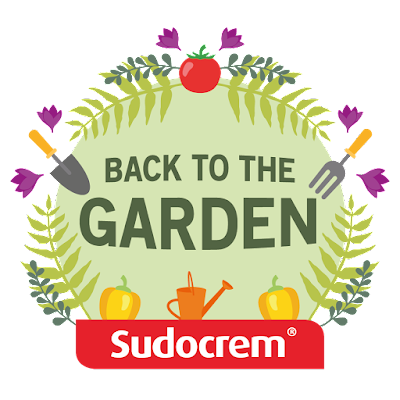 Ad | Sudocrem Back To The Garden logo with flowers and plants