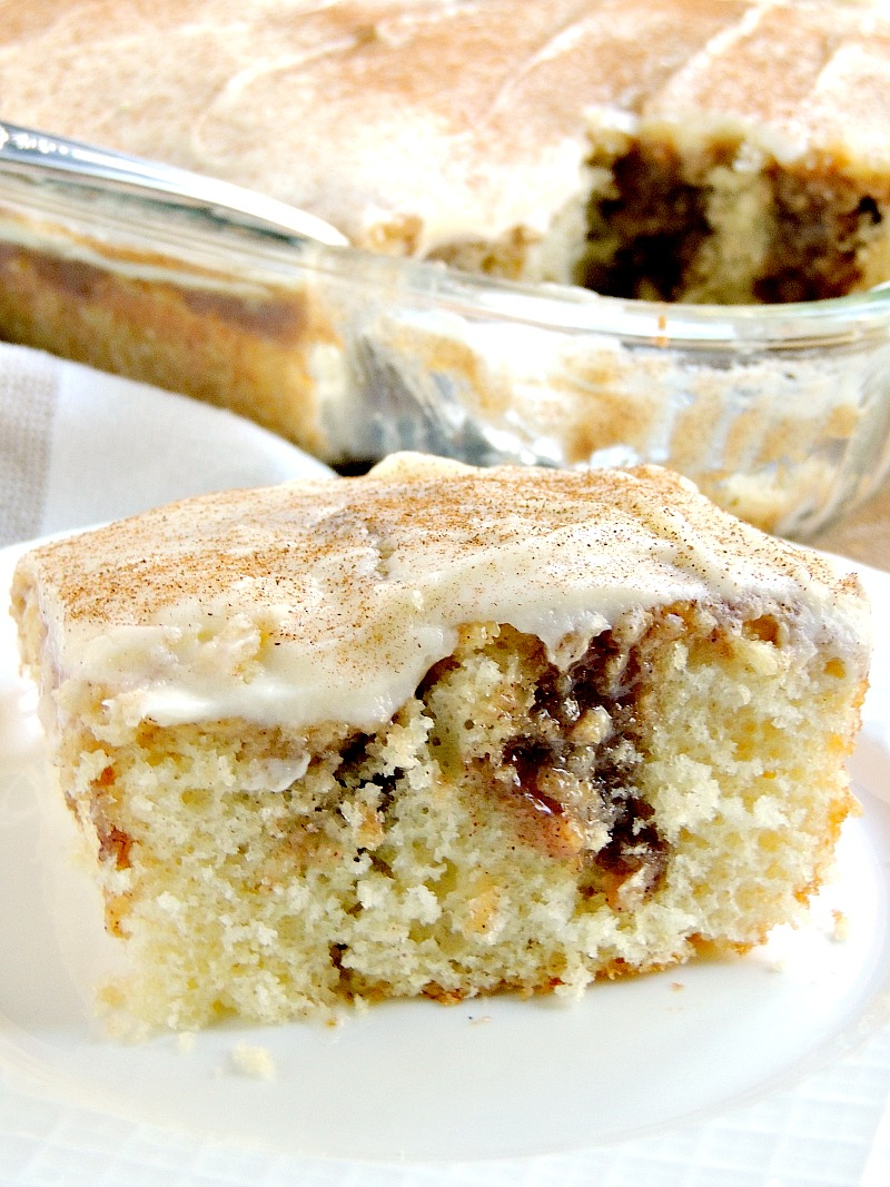 This Cinnamon Roll Poke Cake has all of the flavors of a cinnamon roll and is so moist and tender it melts in your mouth! From www.bobbiskozykitchen.com