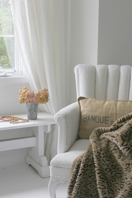 Vintage white chair with leopard throw - Hello Lovely Studio