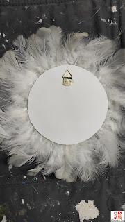 diy espejo con plumas