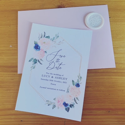 Floral save the dates with envelopes and wax seals