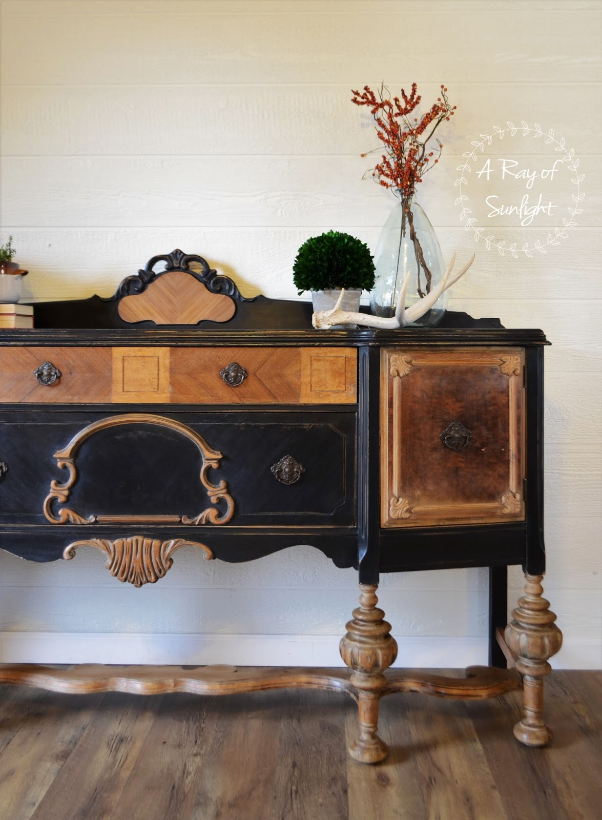This thrift antique buffet was ready for the dump. The veneer was peeling, chipping and bubbling, the finish was worn, and the backsplash needed repair. So we repaired the veneer, removed the veneer, filled in some missing veneer with bondo and stripped the finish down to raw wood. I love the natural wood and black paint together! By A Ray of Sunlight #furnituremakeover #furniturerepair