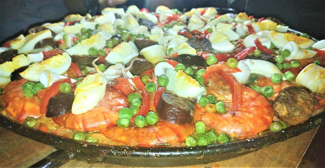Ditto's Paella Valenciana and Negra, an heirloom dish handed down to three generations