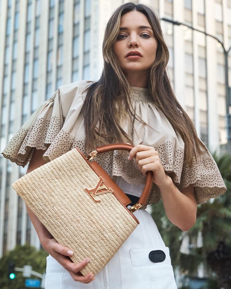 Louis Vuitton Capucines MM bag comes in braided raffia.