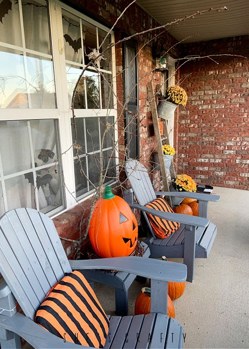 Halloween porch - long and narrow porch on brick house