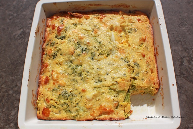 this is a pan of savory cornbread with chilies, cheese and corn in it