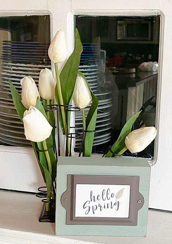 green spring sign and tulips