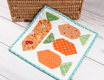 http://www.fatquartershop.com/garden-carrots-mini-quilt-downloadable-pdf-quilt-pattern