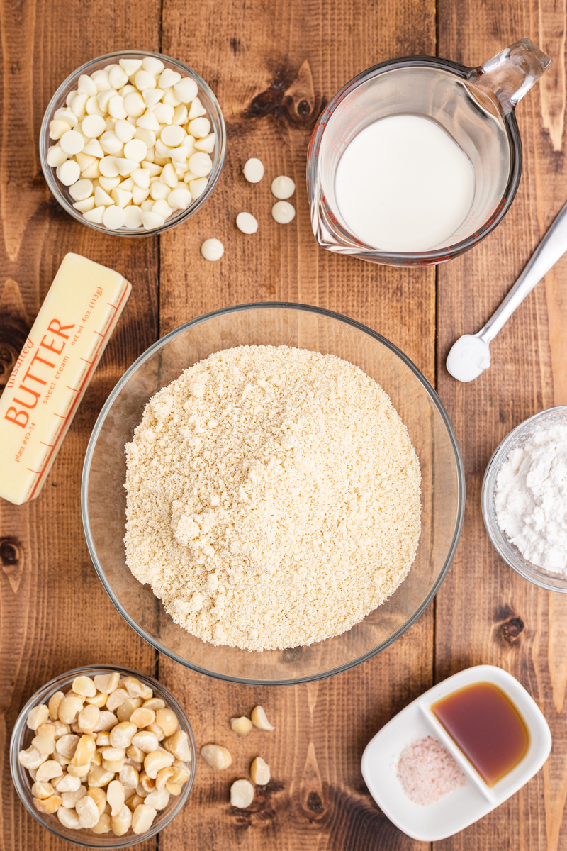 Overhead photo of the ingredients needed to make Keto White Chocolate Macadamia Nut Cookies on a wooden table.