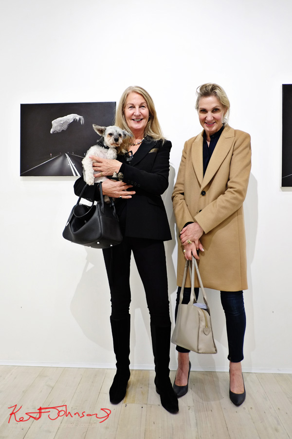 Ladies with coats and black pants and a little dog at Gallery 9. Photographed for Street Fashion Sydney by Kent Johnson.