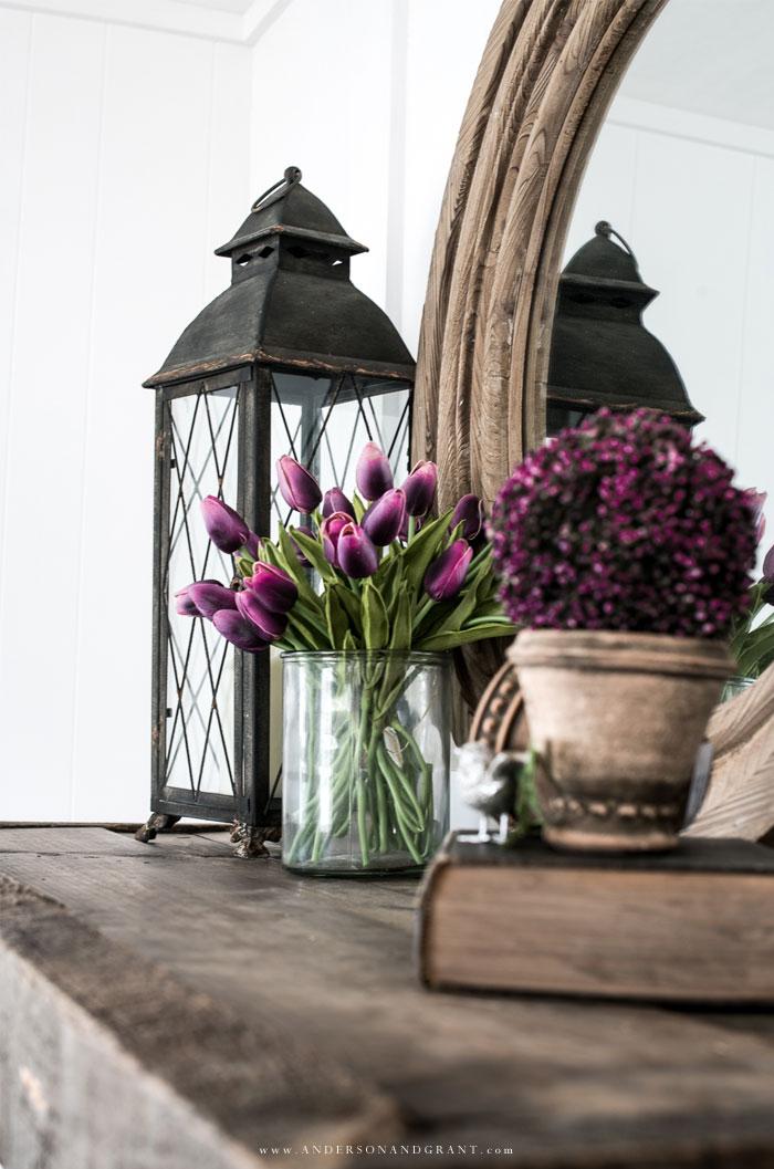 Purple flowers on wood mantel