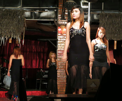 Burmese girls working at night at a show performance