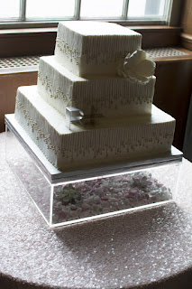 Deep South Brides at 21C Museum Hotel  shot on location by fine art wedding photographer Angela Cappetta tiered wedding cake square