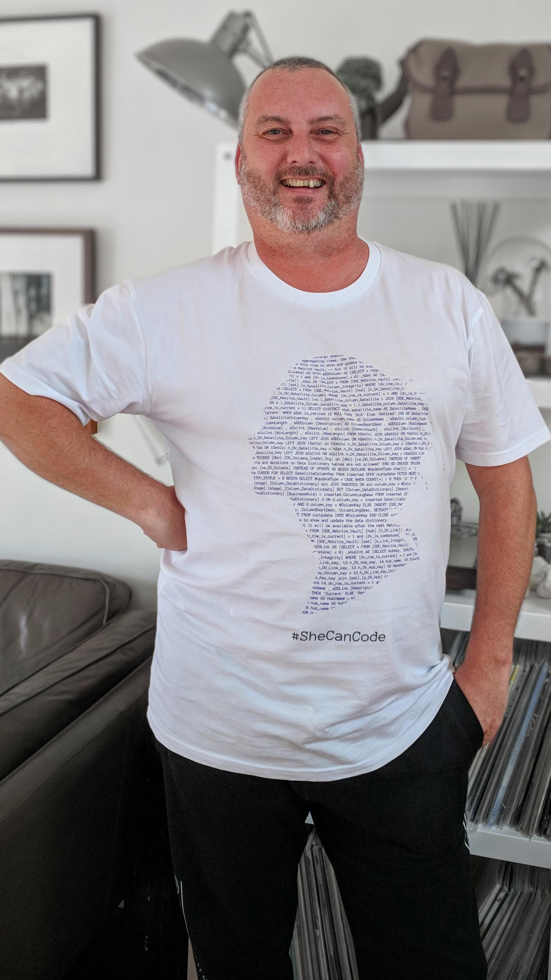 Wearing a #SheCanCode t-shirt