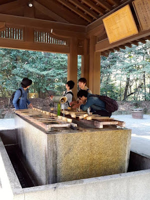 Cleansing ritual at Meiji Shrine Japan