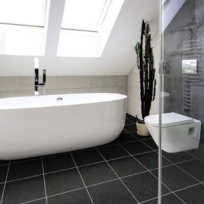 a white bathroom suite sat on grey title effect vinyl flooring