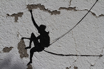 Stencil of climber on wall of Rifugio Lambertenghi-Romanin.