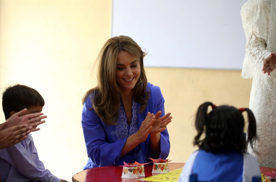 Kate beams as she meets with young school children in Islamabad