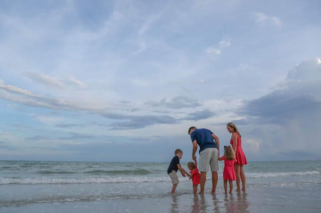 family having professional photograph on sanibel