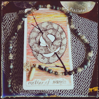Mother of Wands card from The Wild Unknown Tarot
