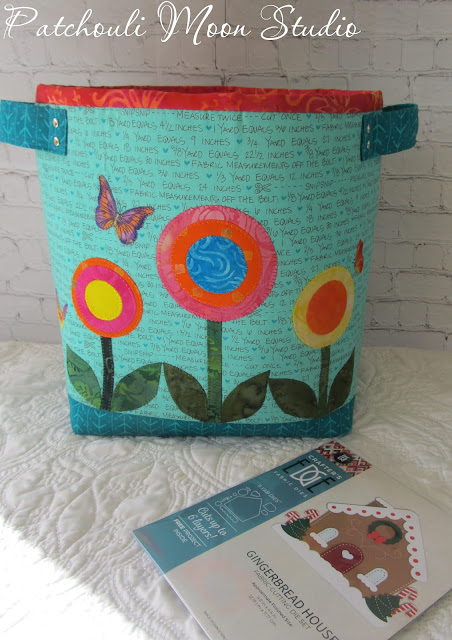 Fabric container with handles and applique circle shaped flowers