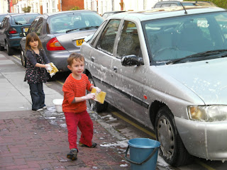 washing the car, child slave labour