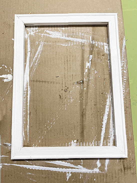 white chalky painted frame