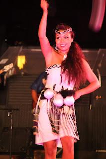 Woman dances at luau.