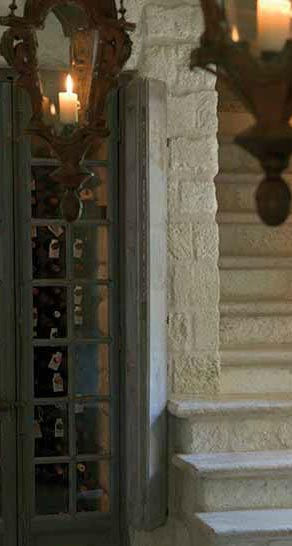 Stone Stairway, Hanging Lanterns, French Doors via Chateau Domingue as seen on linenandlavender.net